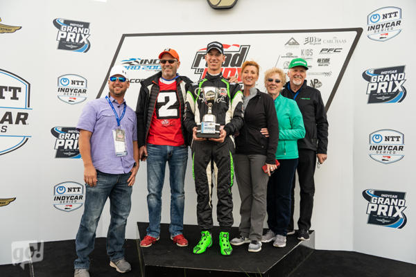 family on podium